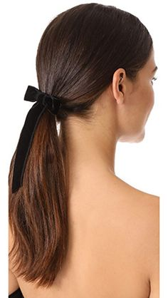 Low ponytail with a black velvet hair bow ribbon.