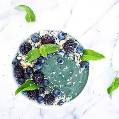 Smoothie bowl perfection with so many amazing good stuff. Supergreens cashew milk avocado blueberries @e3live algae (blue majik) black sesame seeds mint leaves topped with hemp seeds coconut shavings raw cashews black sesame seeds mint leaves blueberries and blackberries.