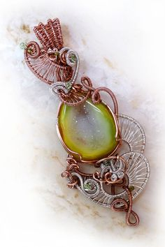 From the beginning I liked how much the druzy looked like a lovely pear, so my design took shape quickly. I was also inspired by an amazing Art Nouveau building I visited in Italy that had beautiful fruits worked into the designs.