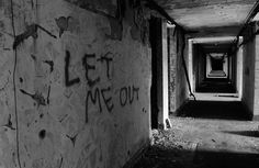Let me out written on the wall at the abandoned Napsbury mental asylum hospital. That could have been graffitied after the place was already abandoned, but what I love about this photo is the light/shadow thing going on, making for a hypnotic image. Abandoned Asylums, Abandoned Buildings, Abandoned Places, Mental Asylum, Insane Asylum, Banksy Graffiti, Abandoned Hospital, Arte Obscura, Theme Halloween
