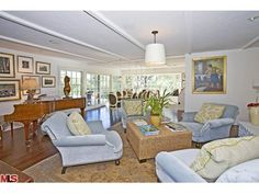 I love the color of these chairs and the placement without a couch.  (Sally Fields' Malibu home)  Maybe she is having a yard sale and is tired of them.