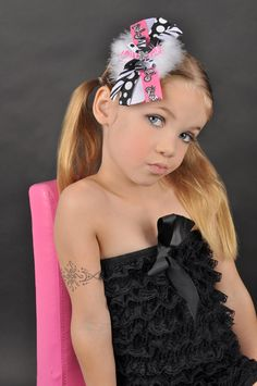 Black, White and Pink Motorcycle Princess Couture Inspired Hair Bow with Feather Puff. $7.00, via Etsy.