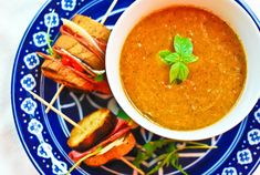"""I love tomato soup. It's just one of those comfort foods that makes you feel all warm and fuzzy inside. I've been seeing all these """"roasted"""" tomato soups on pinterest and I thought, """"I'm going to grill the tomatoes to kick the flavor up a notch with the addition of smoke and char"""". That is …"""
