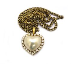 An 18ct gold, heart shaped, mabe pearl and diamond pendant with chain, c.1950. Offered by Shapiro & Co at Grays
