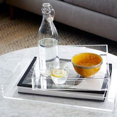 These Acrylic Trays in square and rectangular shapes are made of high-gauge acrylic so they're equal parts sturdy and stylish. Clear and versatile, they'll go with any color palette — use them to serve drinks, or as a catch-all for mail, keys and other odds and ends. Monogram one for a personalized gift.