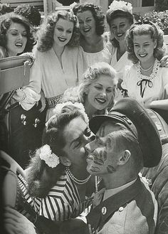John Farnsworth covered in kisses by famous pinups and actresses (L to R: Lynne Baggett, Dolores Moran, Barbara Hale, Ginger Rogers, Gloria DeHaven, Chilli Williams and Jinx Falkenburg.) 1944 http://www.vintag.es/2013/03/john-farnsworth-covered-in-kisses-by.html