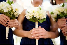 bridesmaids bouquet idea: sweet white bouquets with orchids and hydrangeas.