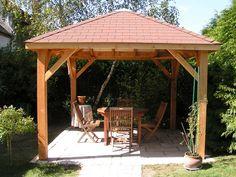 Terrasse en bois avec paliers et pergola patio for Abris de jardin sans dalle beton