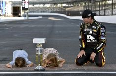 Jeff Gordon with his kids, Leo and Ella, kissing the bricks after winning the 2014 Brickyard 400!