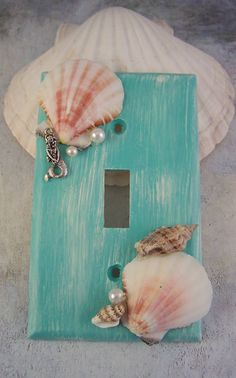 Description: This is a Gorgeous Mermaid Sea Shell Switch Plate Cover Set. You get the 2 plates. You get a light switch plate and a electrical plate. Turquoise and Ivory Distressed Look. They are decorated with Gorgeous Sea Shells, Mermaids and Pearls!!! They are so Pretty! They will