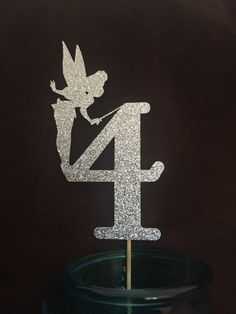 Tinkerbell cake topper with Birthday Girls age. Perfect for a cake topper, centerpiece or as a photo prop.  -Tinkerbell and age both measure 4
