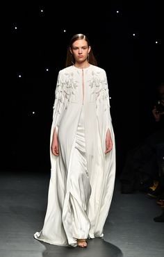 14 runway dresses you can totally wear walking down the aisle, like this satin cape gown.