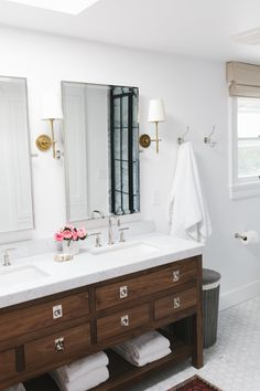Window Trim base boards and Roman shade Walnut vanity and marble hex tile | Studio McGee