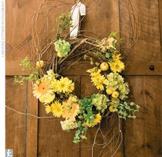 The natural-style flower arrangements were a major element of the style.  Kelli and her dad spent half the day tying the honeysuckle to the trellis, putting metal buckets on chairs, and hanging wreaths on the doors.