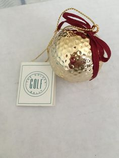 Hello, Unique Good Luck Novelty. Handmade Golf Ball Ornament. Made by Prosperity Tree . This is a Regular Golf Ball coated with a 24KT finish. Inspired by a Scottish Golfer. I appreciate you viewing this item.