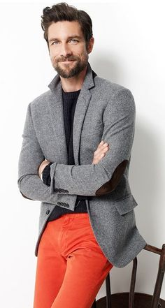 Go for a grey wool sportcoat and red pants to look classy but not particularly formal. Shop this look on Lookastic: https://lookastic.com/men/looks/grey-wool-blazer-black-crew-neck-sweater-red-chinos/13499 — Black Crew-neck Sweater — Grey Wool Blazer — Red Chinos