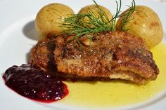 Fried herring, melted butter, lingon berrys and potatoes