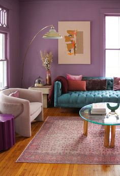 An already gorgeous Victorian house has been energized with bold color. | House Tours by Apartment Therapy #livingrooms #livingroomideas #purpledecor #purplecolorpalette #victorian #victoriandecor #victorianhomes #colorfuldecor #diningtable #chandelier #vintage #vintagedecor #vintagehome Victorian Decor, Victorian Homes, Vintage Decor, Vintage Furniture, Colorful Couch, Colorful Decor, Colorful Rooms, Luxury Homes Interior, Colores Paredes