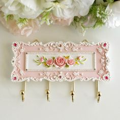 Inspiration only - #ShabbyChic plaque with hooks for hanging items - would be nice to build this up on a tin base with clay/cold porcelain #Crafts ≈√