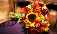 Sunflower, rose and orchid bouquet