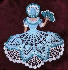 Ravelry: 0655 Miss Belle Crinoline Girl Doily pattern by Cylinda D. Crochet pattern for a thread pineapple crinoline girl doily pattern in the Southern Series Work up our crocheted southern belle with an upper pineapple skirt and lacy underskirt with matc Appliques Au Crochet, Crochet Dollies, Crochet Doily Patterns, Thread Crochet, Crochet Motif, Crochet Crafts, Crochet Flowers, Crochet Stitches, Crochet Projects