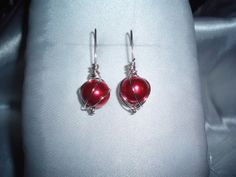 Chaos Wire Wrapped Earring with Metallic Red (bead color wears well with pinks or reds) Glass bead.