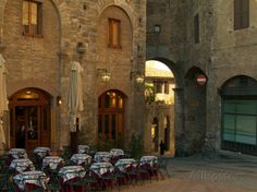 Restaurant in a Small Piazza, San Gimignano, Tuscany, Italy Photographic Print by Janis Miglavs at AllPosters.com