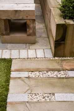 Walkway made up of wood, patio stone and pea gravel