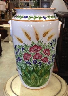 Portaombrelli dipinto a mano. That is to say, hand painted Italian umbrella stand. A a bright and happy piece of imported pottery. 22-1/4 in. tall.