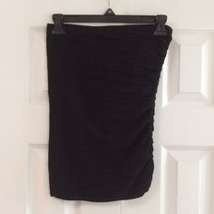 WHBM black tube top The tube top is gathered on the left side and pleated.  The top is gently washed and worn with no stains no rips. White House Black Market Tops Tank Tops