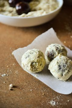 #paleo Spiced Date Truffles: Good quality dates ( seeded and halved) - 10 to 15 nos; 1 tsp Olive oil; 1 Tbsp    Sweetened Cocoa Powder; pinch of Salt | Dusting: 1 Tbsp Roasted Almonds; 1 Tbsp Roasted Pistachios; 1 Tbsp Roasted cashew nuts; 2 to 3 nos Cardamom pods; 1/8 tsp Nutmeg powder; 1 pinch Turmeric powder;   SUBSTITUTE Coconut Crystals for 1-1/2 to 2 Tbsp Raw Sugar