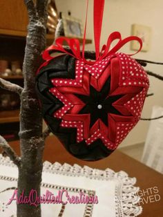 Check out this item in my Etsy shop https://www.etsy.com/listing/504321548/quilted-heart-ornament-folded-fabric