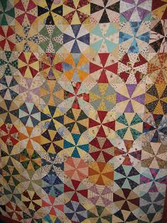 Kaleidoscope quilt.  Pieced with all straight lines, but appears as curves.