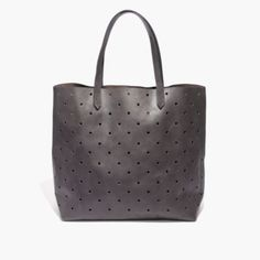 What goes into the perforated version our signature tote? Here it is by the numbers: 2 pieces of fine leather are used for the body. 8 inches of strap drop: long enough to sling over your shoulder, but short enough to hold as a top handle. 1 interior side zip pocket to keep your keys, phone and wallet at the ready. 24: the number of hours in a day that this bag looks cool. How often you'll reach for it? 500 gazillion times. <ul><li>Made of Italian vegetable-tanned leather that burnishes…