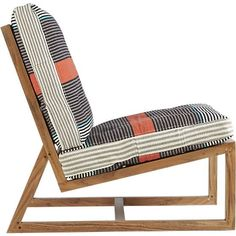 '70s throwback. Wood lounger leans back in time and space on slim acacia Danish-style frame. Loose dhurrie cotton cushions retro vibe in wide, retro stripes of orange, grey, cream and turquoise comfortably support hours of downtime. 100% acacia frame100% cotton dhurrie back and seat cushions with cotton fillerIndoor use onlyDry clean cushionsMade in India of domestic and imported materials.