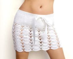 Fuente: http://www.etsy.com/listing/98542585/crochet-beach-mini-skirt-in-white-cotton