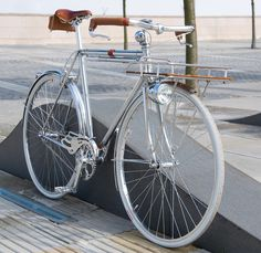 According to Remodelista and GBlog, this 1970's Carlton frame was customized and accessorized over a 3 month period by the folks at details, a design agency. They were inspired by a bike made by Alex Hatfield, winner of the Bespoke Bristol Handmade Bicycle Show. They sourced parts from eBay, Velo Orange, and other places.
