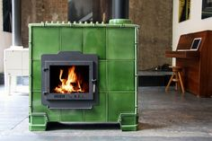 Green Tilestove Big, by Weltevree - Tilestoves are woodstoves with a Corten® steel body and an exterior of ceramic tiles. These ceramic tiles gradually emit the heat of the fire.