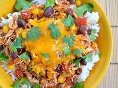 These Slow Cooker Taco Chicken bowls are as easy as 1-2-3. The recipe makes a big batch, but leftovers will get eaten fast! Step by step photos.