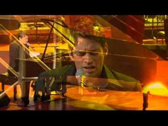 Harry Connick Jr; singing She thinks I still care