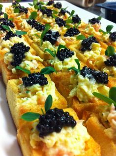 Brioches with scrambled eggs & smoked salmon topped w/ caviar