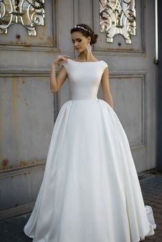 Plain, classic, boat neck with a full skirt