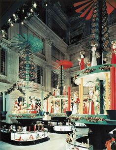 In the 1950s, Marshall Field's in Chicago created these massive spinning Christmas tree decorations inside its central shopping hall. Image ...