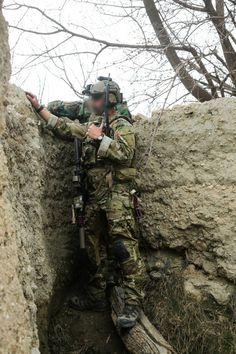 A U.S. Special Forces soldier, attached to Combined Joint Special Operations Task Force-Afghanistan, observes a squad of commandos clear a compound with hostile insurgent activity during an operation in Khogyani district, Nangarhar province, Afghanistan, March 20, 2014. Commandos of 6th Special Operations Kandak, advised and assisted by U.S. Special Forces soldiers, conducted the operation to disrupt insurgent freedom of maneuver. (U.S. Army photo by Spc. Connor Mendez/Released)