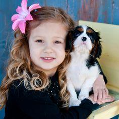 Soo sweet.  Cavalier King Charles Spaniel naturally love children!