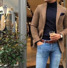 Buy the look on Lookastic: lookastic.fr / … – Brown wool blazer – Navy clutch bag – Black turtleneck sweater – Brown braided leather belt – Light blue jeans by Fashion Night, Sport Fashion, Look Fashion, Fashion Suits, Fashion Men, Fashion Ideas, Mens Fashion Blazer, Fashion Clothes, Style Clothes
