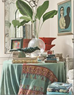 """All of my """"team colors"""" right here in this gorgeous photo!  highlighted in the first issue of Milieu.  I received mine in the mail today.   Milieu Magazine's premier issue: Mary Jane Ryburn's Dallas living room corner includes a 19th-century Venetian mirror, """"Me and My Shadow"""" by Susie Phillips, and an antique Indian sari over the table. Photo by Peter Vitale."""