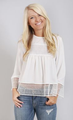 Crochet is the key to our heart! This blouse features crochet trim across the…
