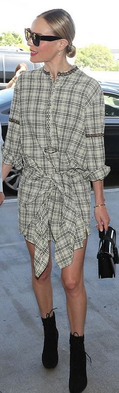Who made  Kate Bosworth's black ankle boots, sunglasses, patent handbag, and plaid tie dress?