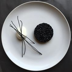 """Minimalist Art Plating"" Black ink risotto with mozzarella and fried black spaghetti by @royalebrat #GourmetArtistry"